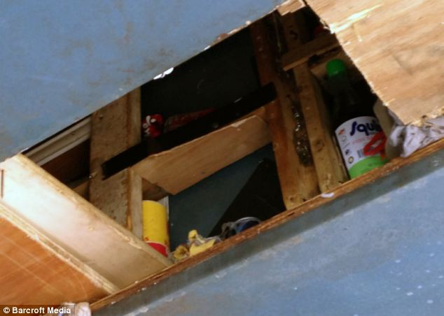 Looking inside: An image shows the inside of the man's home as officers continue to pull it down