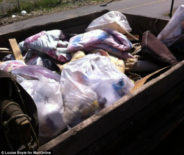 Carted away: His items, including bedding and wood, filled a truck near to the Manhattan Bridge