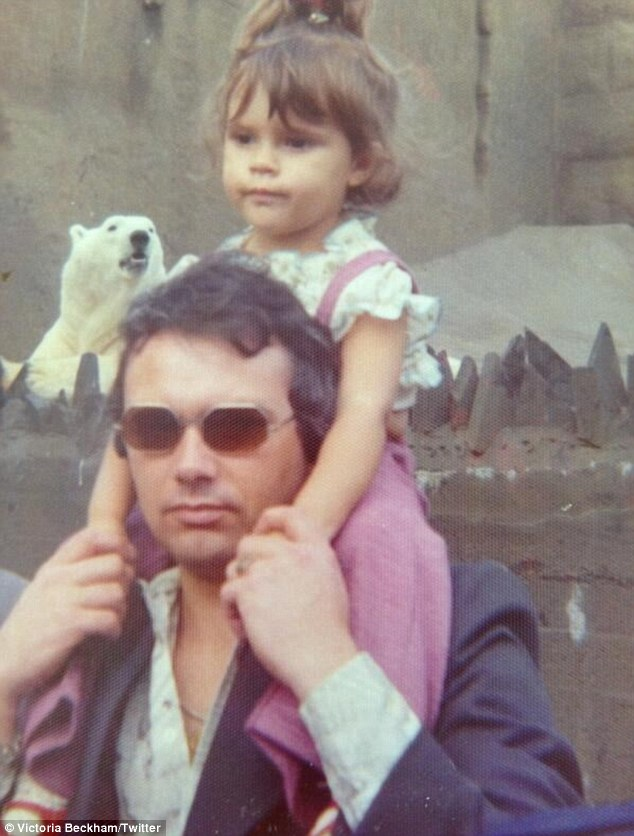 Me and my cool dad: A separate shot sees an infant Victoria perched father Anthony's shoulders during a trip to the zoo