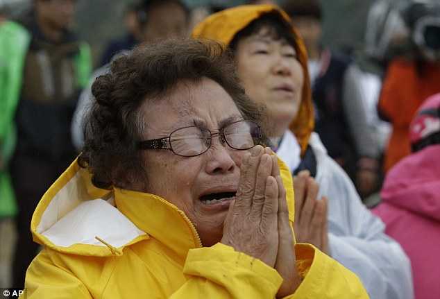 A relative cries while waiting for news of her loved ones. 270 victims are still unaccounted for