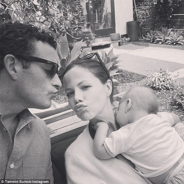 Spring has sprung! Tammin Sursok and her husband Sean McEwen snuggle up with their baby girl Phoenix Emmanuel on Thursday
