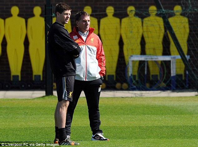 Looking good: Rodgers and Gerrard watch on at a Melwood training session