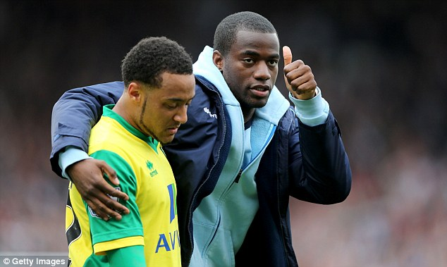Thumbs up: Sebastein Bassong (right) could be in line for a return to Norwich's team under Neil Adams