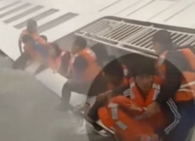 In shock: The young girl, highlighted, became separated from her parents and brother, when she was passed on to rescuers
