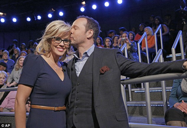 Awww... Donnie, dressed in a suit, stopped by The View last Wednesday to give his fiancé a kiss, the day she announced the engagement