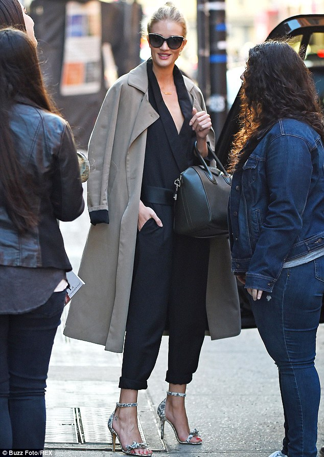 Back to reality: Rosie Huntington-Whiteley was spotted leaving Milk Studios in New York City on Thursday