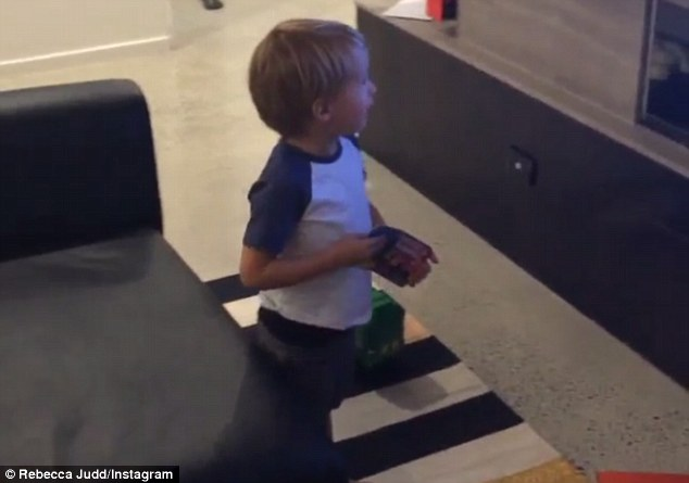 Judd named: Oscar excitedly read the news headlines and his mother Rebecca posted the cute moment on Instagram