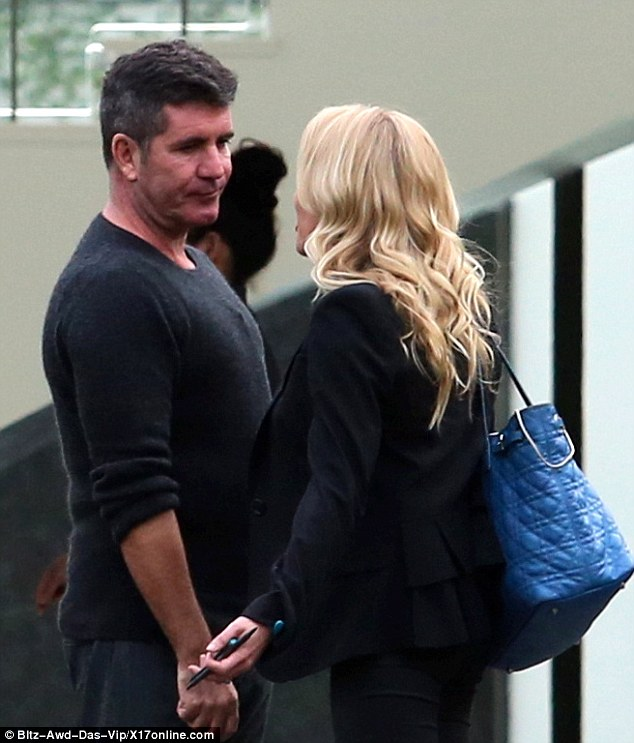 Words of wisdom: AnnMarie was seen chatting away to Simon, perhaps offering him so advice
