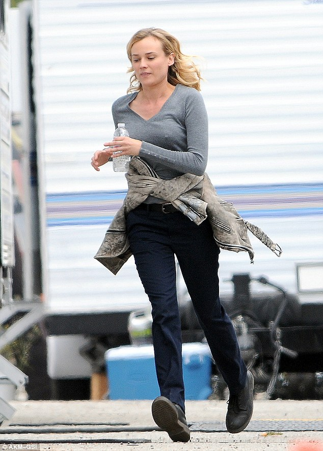 On the run: The 37-year-old jogged while on the set