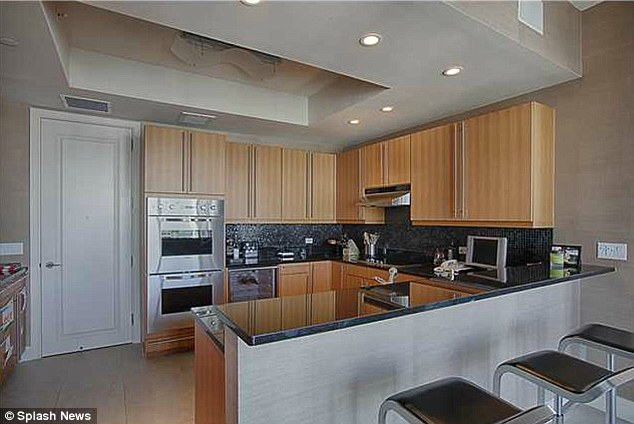 Lavish: A large kitchen with stainless steel appliances