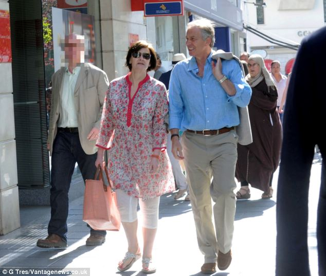 Tony Blair and his wife Cherie were pictured walking down a street in Marbella, southern Spain last month