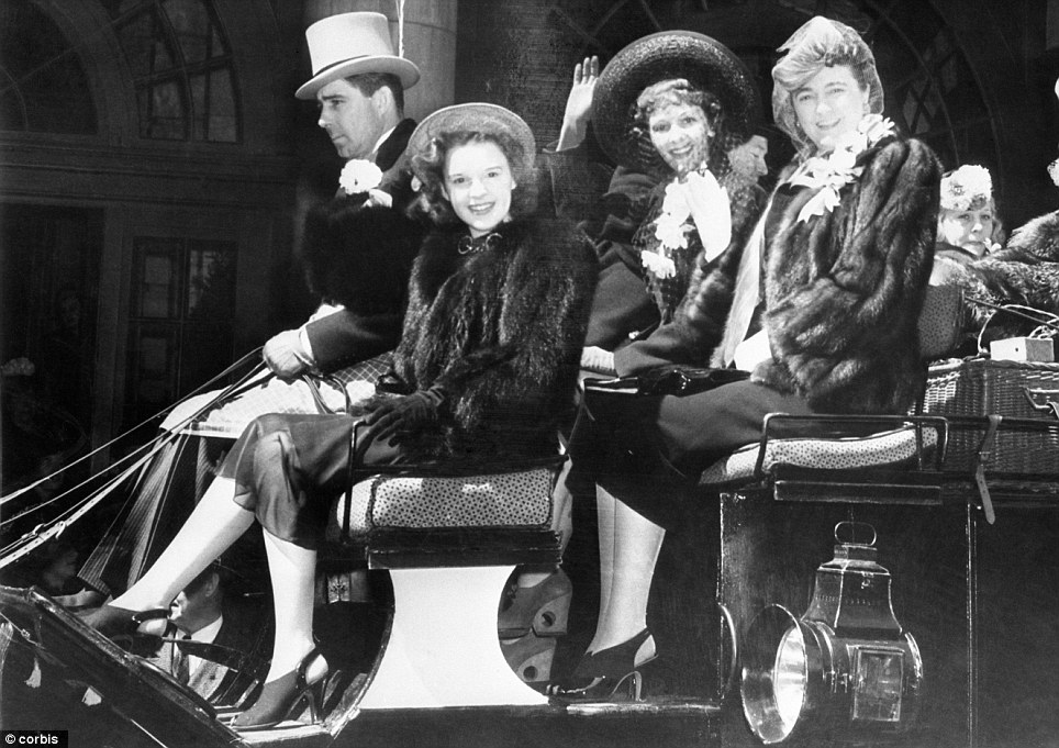 Star smile: Joining the A-star line-up is a 15-year-old Judy Garland riding in a horse and cart wearing furs in 1939. Ironically, nine years later she would be responsible for immortalizing Manhattan's famous pageant by staring in Irving Berlin's hit film Easter Parade opposite Fred Astaire