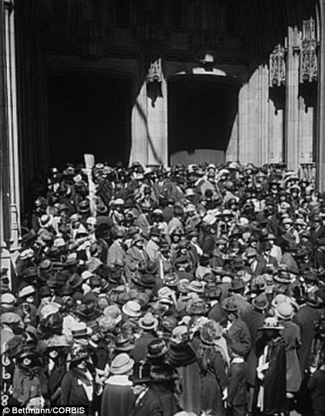 17 Apr 1922 --- Original caption: New York, New York: Easter Sunday on Fifth Avenue. Crowds storming St. Thomas Church to attend services