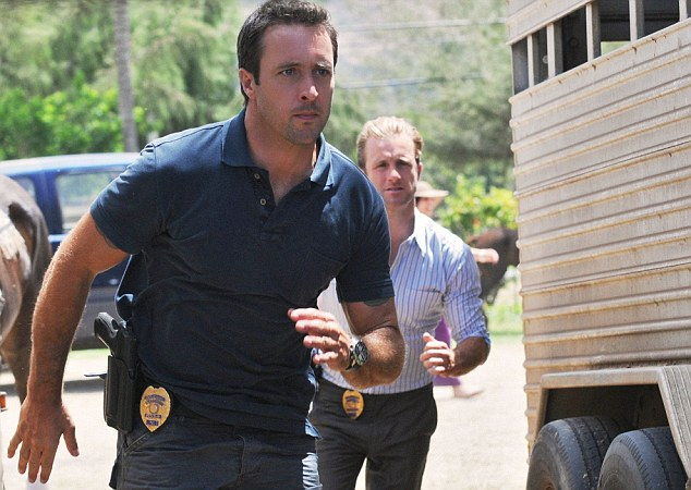 Cops and robbers: Alex and co-star Scott Caan play police officers in Honolulu