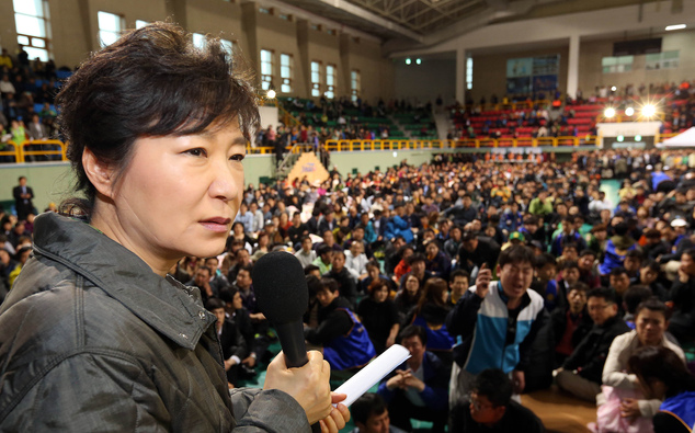 South Korean President Park Geun-hye speaks during a meeting with parents whose children are now missing in Ship Sewol at a gymnasium in Jindo, South Korea, ...