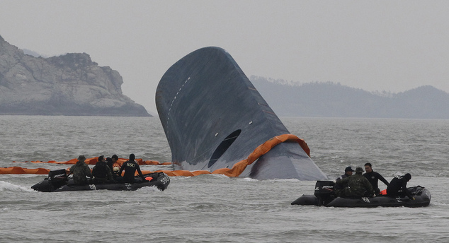 AP10ThingsToSee - South Korean Coast Guard officers search for missing passengers aboard a sunken ferry in the waters off the southern coast near Jindo, Sout...
