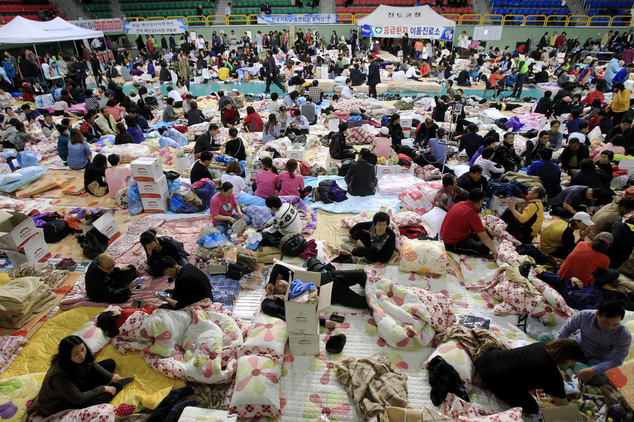 Family members of children are still missing in the sunken ferry the Sewol gather at a gymnasium in Jindo