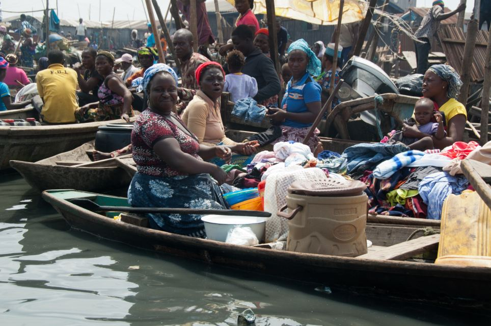 Life revolves around the water with people living, working and shopping on small row boats