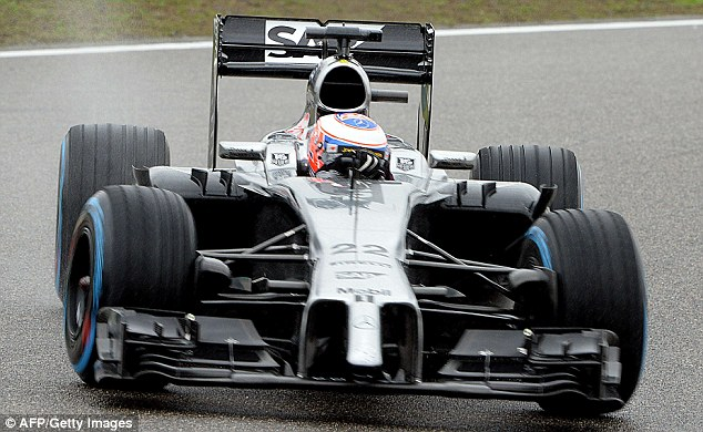 Out of sorts: Jenson Button will start tomorrow's Chinese Grand Prix from 12th after struggling in the wet