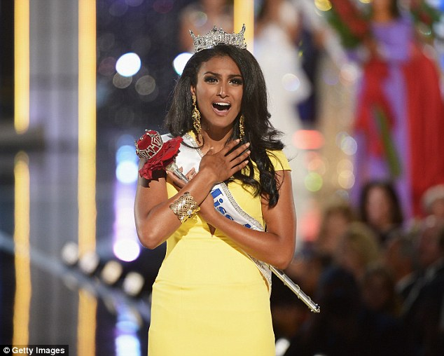 Nina Davuluri, representing New York, reacts after being crowned Miss America on September 15, 2013 in Atlantic City, New Jersey