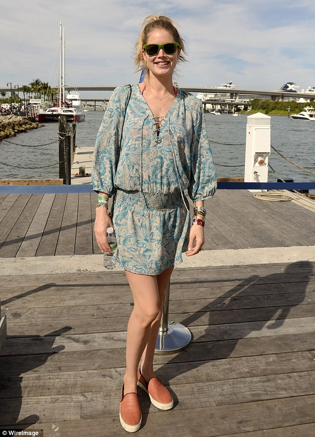 Smaller bump: The Victoria's Secret angel camouflaged her pregnancy beneath a loose-fitted blue paisley dress at Ultra Music Festival in Miami, Florida on March 30