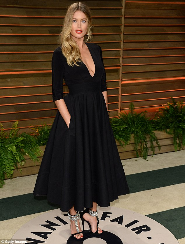 Fair lady: The blonde stunner went dramatic in a plunging black frock as she attended the Vanity Fair Oscar Party in LA on March 2