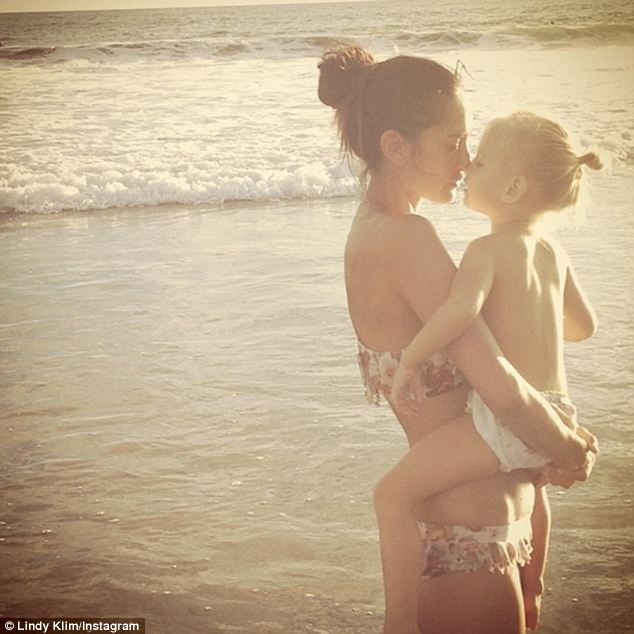 Beach-side kisses! A tender moment between Lindy and her youngest daughter Frankie