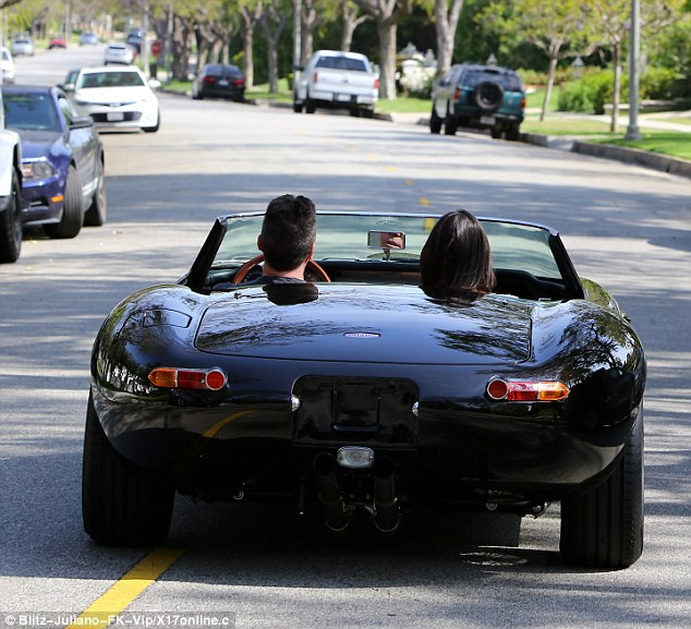 Beep beep: Other cars seemed to stand aside as the King Of Jaguars cruised down the boulevard