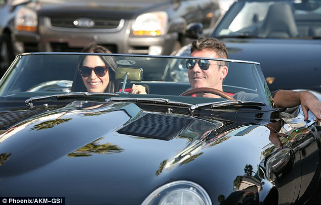 The good life: Simon steered the Jaguar through the traffic with a satisfied smile