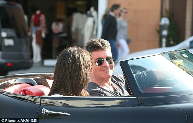 Loving it: The super-loaded sports car cost Cowell upwards of $1 million but it was obviously worth every cent
