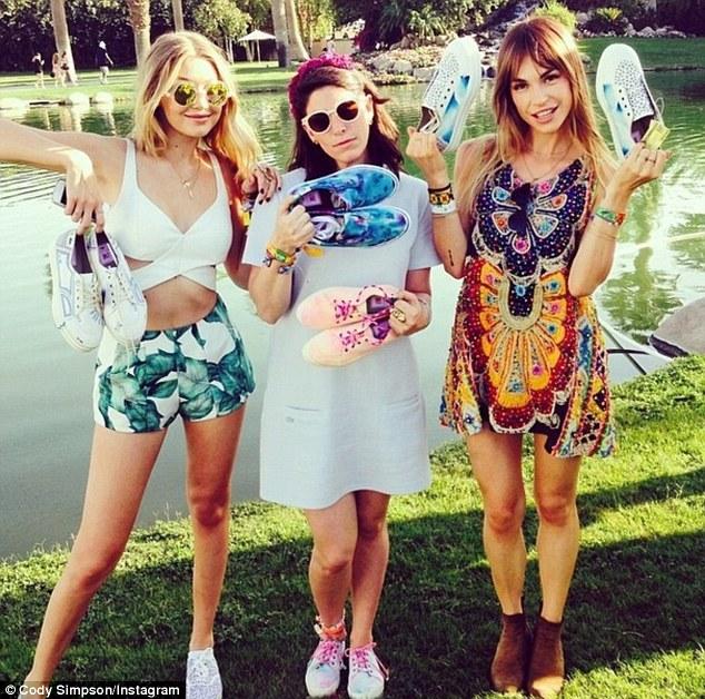 Model girlfriend! Gigi Hadid (far left) pictured with Joe Jonas' girlfriend Blanda Eggenschwiler and another friend at Coachella last weekend