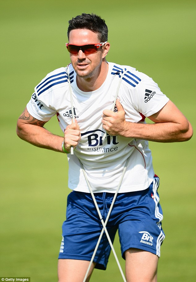 Pietersen goes through some stretching exercises during an England nets session at Lord's