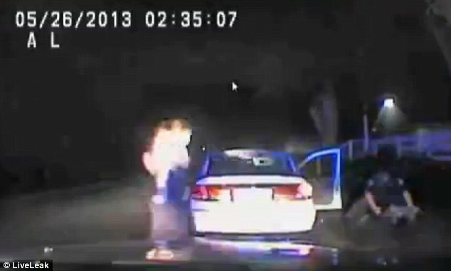 Stunned: The officer repeatedly shoots him with the Taser while backup arrives