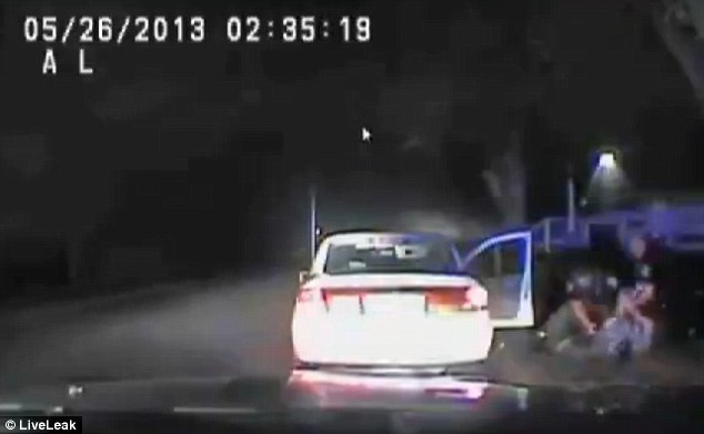 Excessive?: Four officers beat and restrain the victim until he can be handcuffed