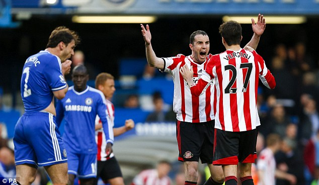 Jubilation: Sunderland's John O'Shea and Santiago Vergini (right) react at the final whistle