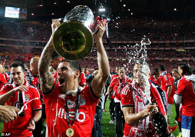 Top dogs: Benfica's victory ends Porto's three-year dominance of the Portuguese league