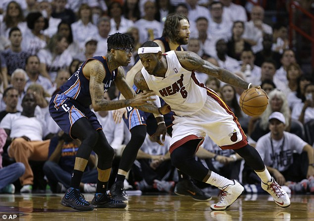 On fire: Miami Heat star LeBron James drives to the basket on his way to 27 points against Charlotte Bobcats