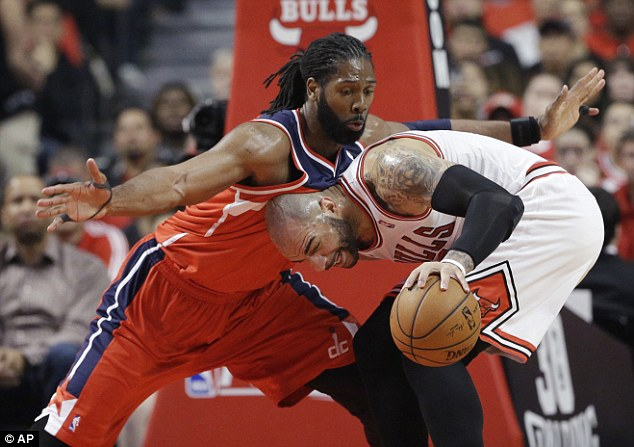Power: Washington forward Nene featured for the Wizards as they upset the Chicago Bulls on Sunday