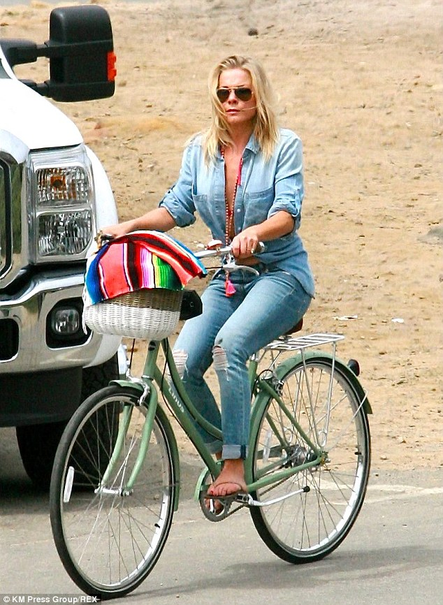 Leaving them wanting more! LeAnn Rimes showed off part of her red bikini and toned abdomen while on family vacation in Santa Barbara, California on Friday