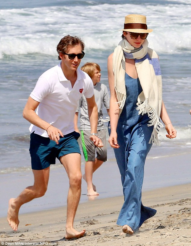 Beach chic: Anne sported a robin's egg blue jumpsuit that billowed in the breeze, with a large blue and white scarf wrapped round her neck
