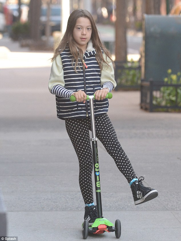 Funky: Ava sported white polka dotted leggings with a striped jacket and black sneakers