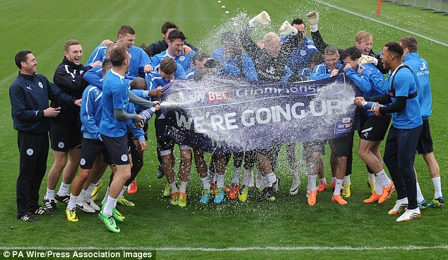 Back in the big time: Leicester have won promotion back to the Premier League