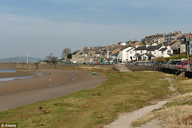 Warning zone: The stretch of sand in Arnside, Cumbria, where a boy got stuck in quicksand