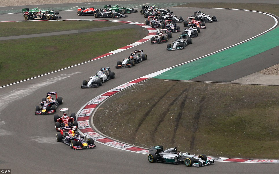 Pole position: Britain's Lewis Hamilton leads the field into turn three at the start of the Chinese Formula One Grand Prix at the Shanghai International Circuit