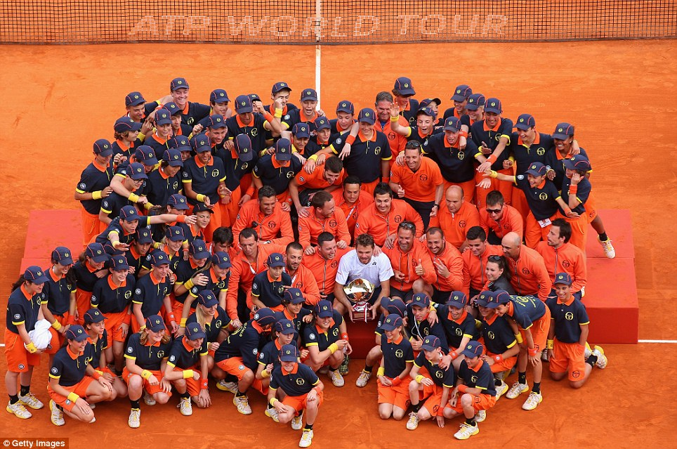 Swiss Cheese: Tennis player Stanislas Wawrinka of Switzerland smiles for the camera with ball boys, girls and ground staff after defeating fellow countryman Roger Federer in the final of the Monte-Carlo Masters in Monaco