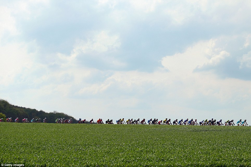 Clouds and Crowds: Cyclists in action during the 49th edition of the Amstel Gold Race in Maastricht, Netherland