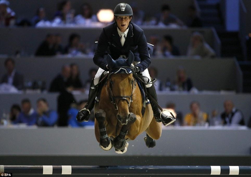 The leap: German rider Daniel Deusser, on horse Fyloe V. Claenyssenhof, competes in the CSI 3 Grand Prix Airbus Group Jumping final, held near Lyon, France