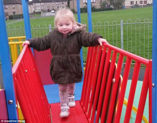 Witnesses say girl's 'lifeless' body was carried out of the house by medics on Sunday night after shouting was heard