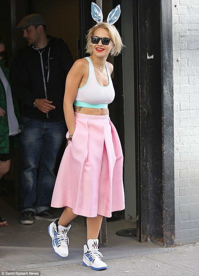 Blonde beauty: Rita Ora was clearly keen not to let Easter pass her by without getting into the holiday spirit as she showed by putting on a pair of bunny ears on Sunday