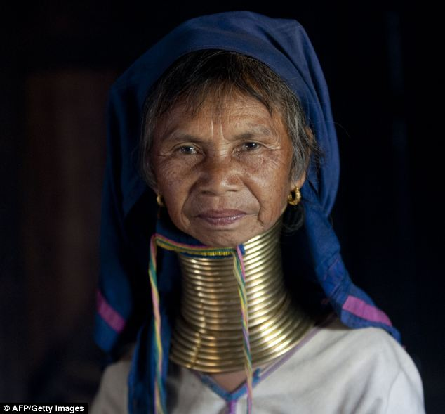 The Kayan women of eastern Burma wear brass rings around their necks to make them appear longer